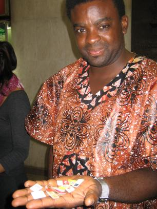 Traveling man: Kunle Afolayan with his SIM cards, Brazil, 2012